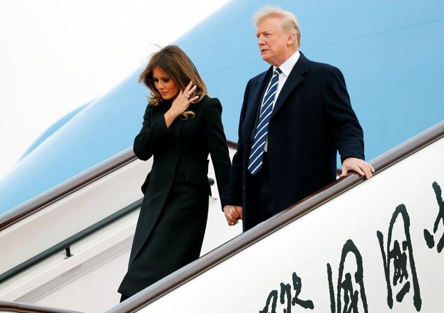 U.S. President Donald Trump and first lady Melania arrive on Air Force One at Beijing, China, November 8, 2017.