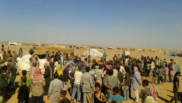 Les réfugiés du camp syrien d'Al-Roukban - Sputnik France