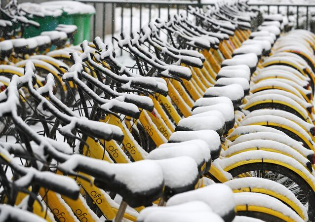 Ofo shared bicycles are seen covered with snow in Zhengzhou, Henan province, China January 4, 2018.
