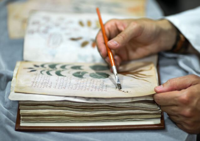 Luis Miguel quality control operator of the Spanish publishing Siloe working on cloning the 'Codex Voynich' Yale University, in Burgos province on August 9, 2016.