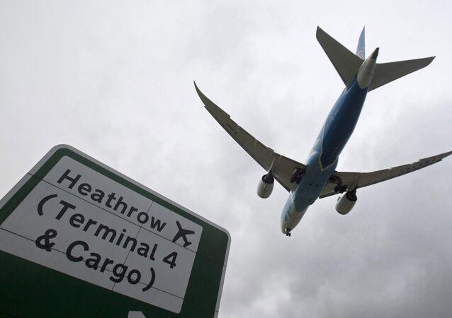 An aircraft lands at Heathrow Airport near London, Britain, December 11, 2015