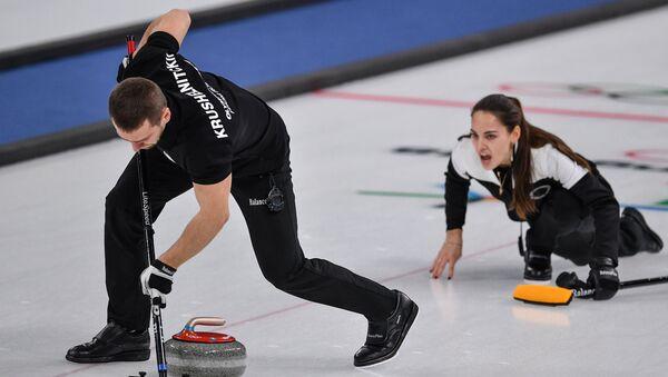 Alexander Krushelnitsky et Anastasia Bryzgalova au tournoi olympique de curling 2018 - Sputnik France