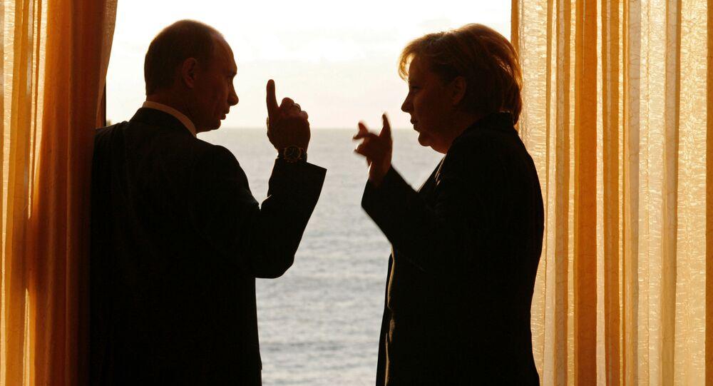 Vladimir Poutine et Angela Merkel