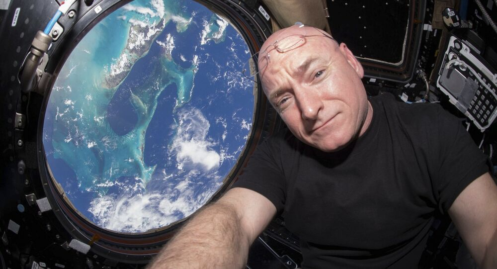 NASA astronaut Scott Kelly is seen inside the cupola of the International Space Station, a special module that provides a 360-degree viewing of the Earth and the station in this undated photo released on March 11, 2016
