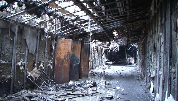 Le centre commercial Zimniaïa Vichnia de Kemerovo ravagé par un incendie - Sputnik France