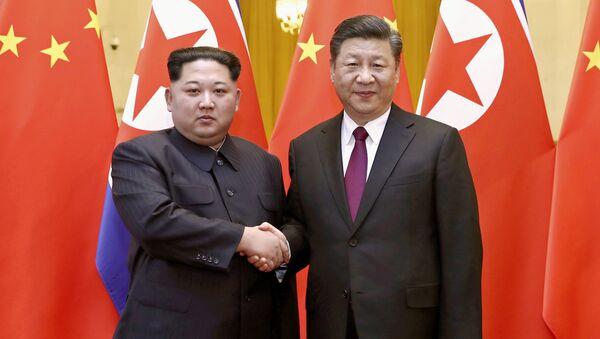 Kim Jong Un et Xi Jingping - Sputnik France