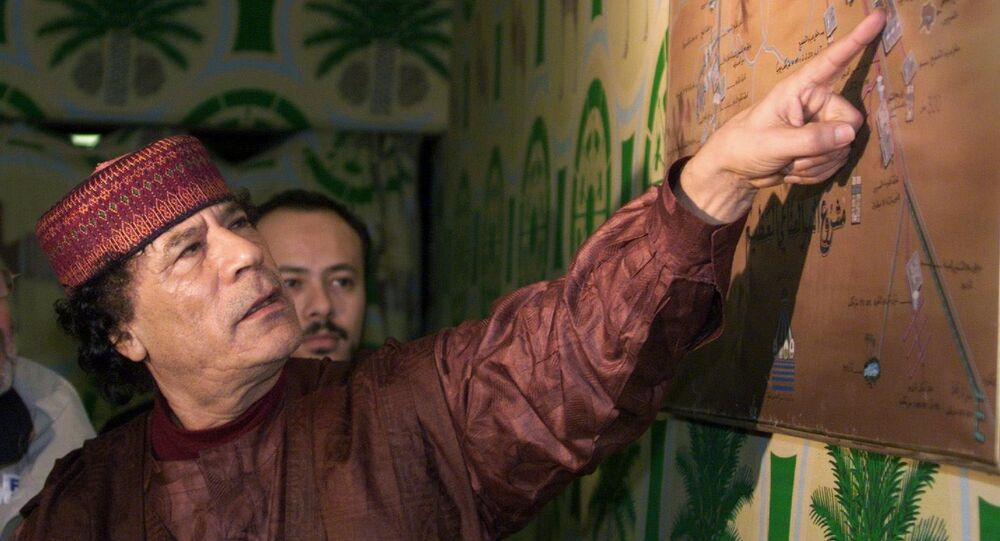 Libyan Colonel Moamer Kadhafi shows his plan for irrigating the Libyan desert by a system of artificial lakes and rivers at his bunker-camp in Tripoli. (File)