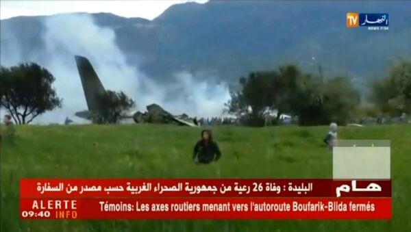 A grab from a video brodcast by Algeria's Ennahar satellite television channel on April 11, 2018 shows the scene of the crash of a transport plane, carrying around 100 Algerian army personnel on board. - Sputnik France