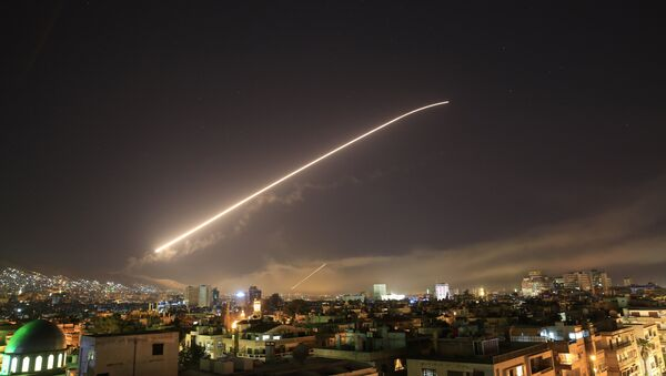 Damascus sky lights up with service to air missile fire as the U.S. launches an attack on Syria targeting different parts of the Syrian capital Damascus, Syria, early Saturday, April 14, 2018. - Sputnik France