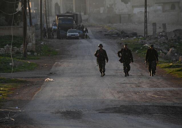Militaires syriens dans la province de Hama