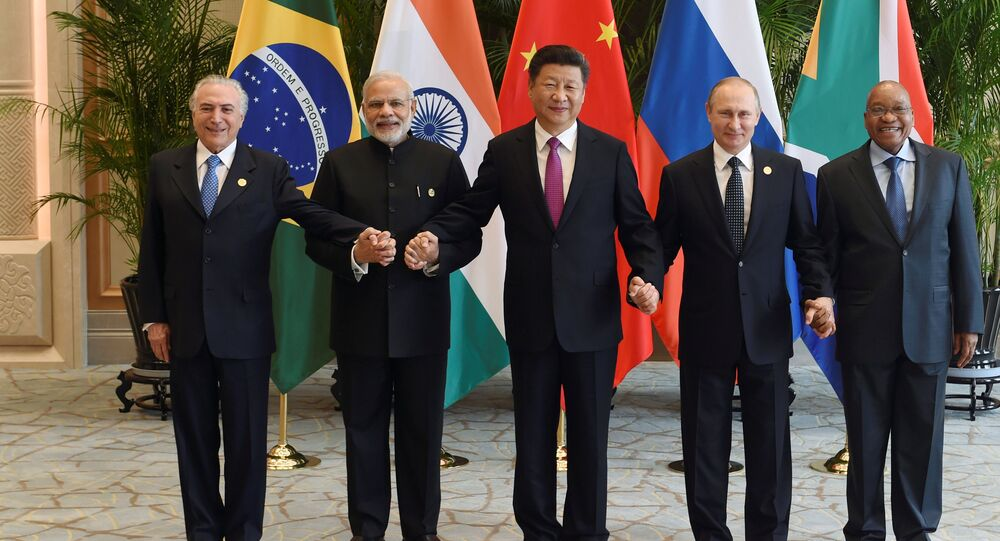 Chinese President Xi Jinping (C) takes a group photo with Indian Prime Minister Narendra Modi (2nd L), Brazil's President Michel Temer (L), Russian President Vladimir Putin (2nd R) and South Africa's President Jacob Zuma at the West Lake State Guest House ahead of G20 Summit in Hangzhou, Zhejiang province, China, September 4, 2016