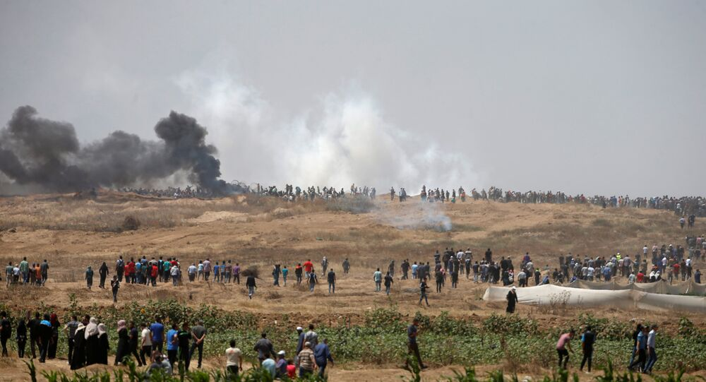 Palestinian demonstrators gather during a protest against U.S. embassy move to Jerusalem and ahead of the 70th anniversary of Nakba, at the Israel-Gaza border, east of Gaza City May 14, 2018.