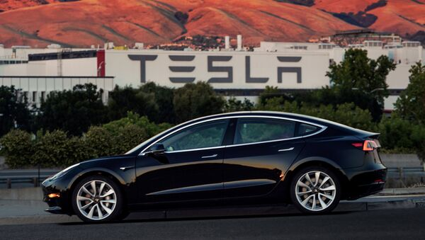 First production model of Tesla Model 3 out the assembly line is seen in this undated handout photo from Tesla Motors. - Sputnik France