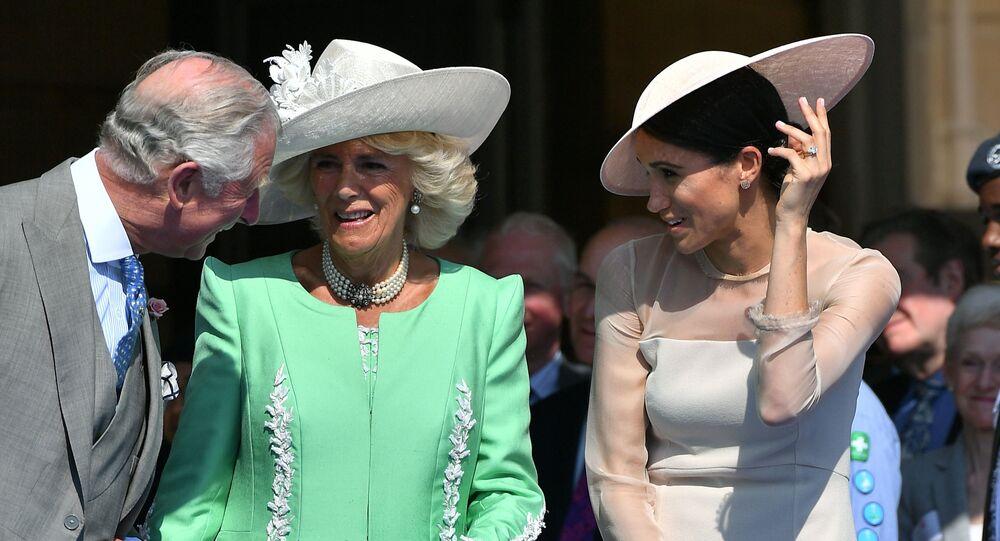 Prince Charles de Galles, son épouse Camilla Parker Bowles et Meghan Markle