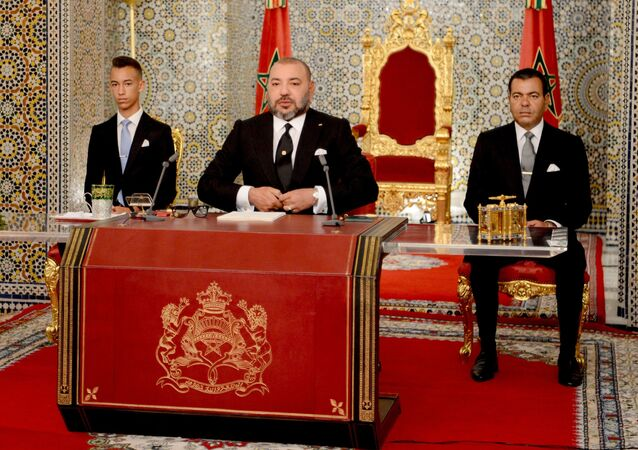 In this photo provided by the Moroccan Royal Palace, King Mohammed VI, foreground, is flanked by his brother Prince Moulay Rachid, right, and Crown Prince Moulay Hassan, during a speech to the nation on the occasion of the 18th anniversary of ascending to the throne, at the royal palace in Tetouan, northern Morocco, on Saturday July 29, 2017.