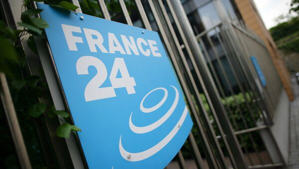 A picture taken on May 3, 2011 in Issy-Les-Moulineaux, a south-western Paris suburb, shows the logo of French International news TV channel France 24 at the headquarters entrance. - Sputnik France