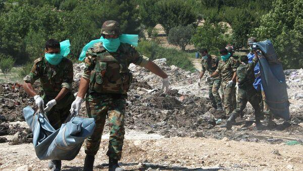 Fosses communes, corps mutilés, mines antipersonnel: le paysage d'Alep-Est libéré - Sputnik France