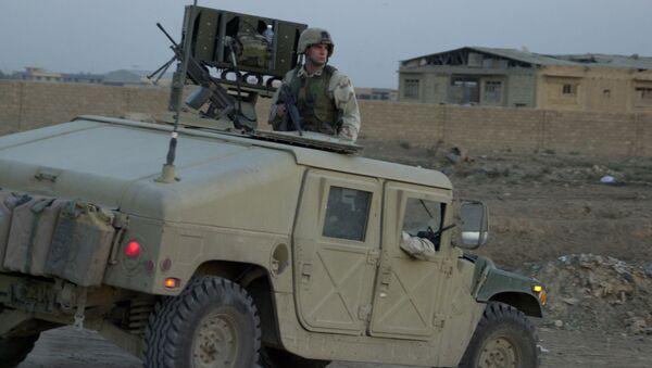 Un soldat américain à bord d'un Humvee - Sputnik France
