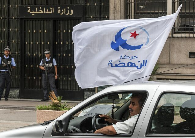 Militants of moderate islamist party Ennahda , waving their party flag, drive past the Interior Minister in Tunis, Monday, Oct.6, 2014.