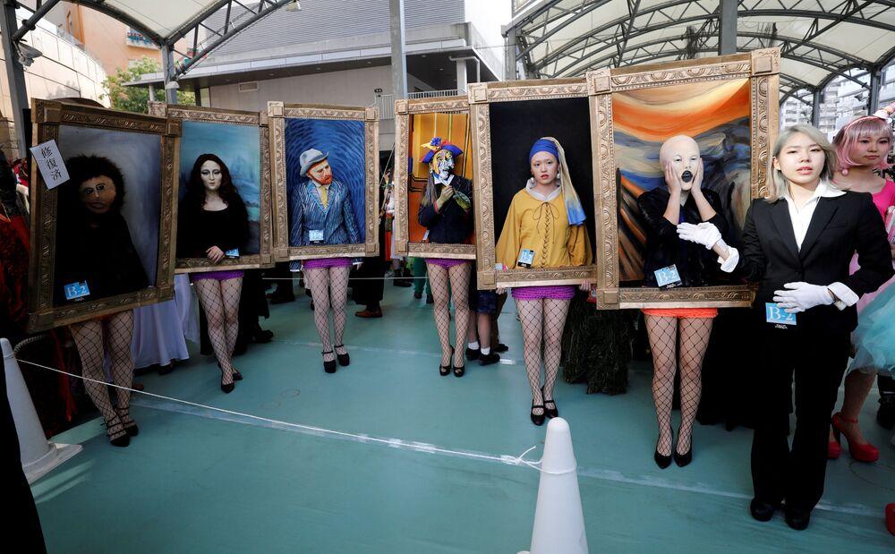 УчасLes photos qui ont marqué la semaine (27 octobre - 2 novembre)тники парада в честь Хеллоуина в Кавасаки, Япония