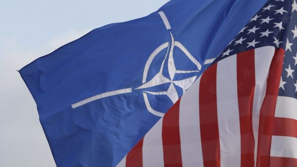 NATO and US flags wave in the wind outside NATO headquarters in Brussels on Friday, Oct. 21, 2011. - Sputnik France