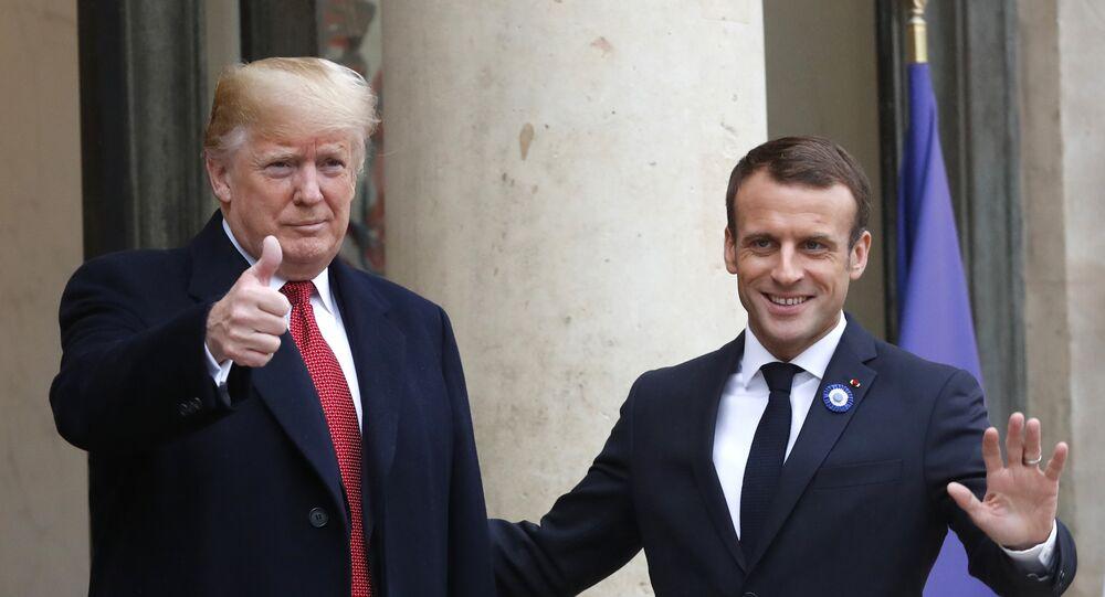 French President Emmanuel Macron, right, and U.S President Donald Trump thumb up at the Elysee Palace in Paris, Saturday, Nov.10, 2018.