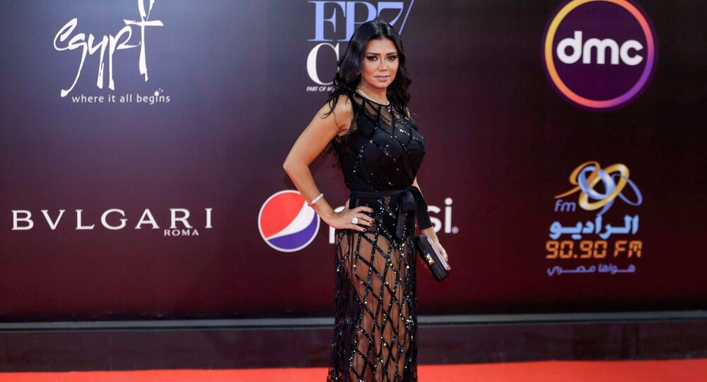 Egyptian actress Rania Youssef poses on the red carpet at the closing ceremony of the 40th edition of the Cairo International Film Festival (CIFF) at the Cairo Opera House in the Egyptian capital on November 29, 2018