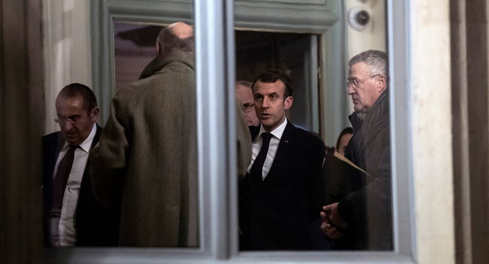 French President Emmanuel Macron (2-R) leaves an emergency meeting at the Interior Ministry in Paris, France, late 11 December 2018