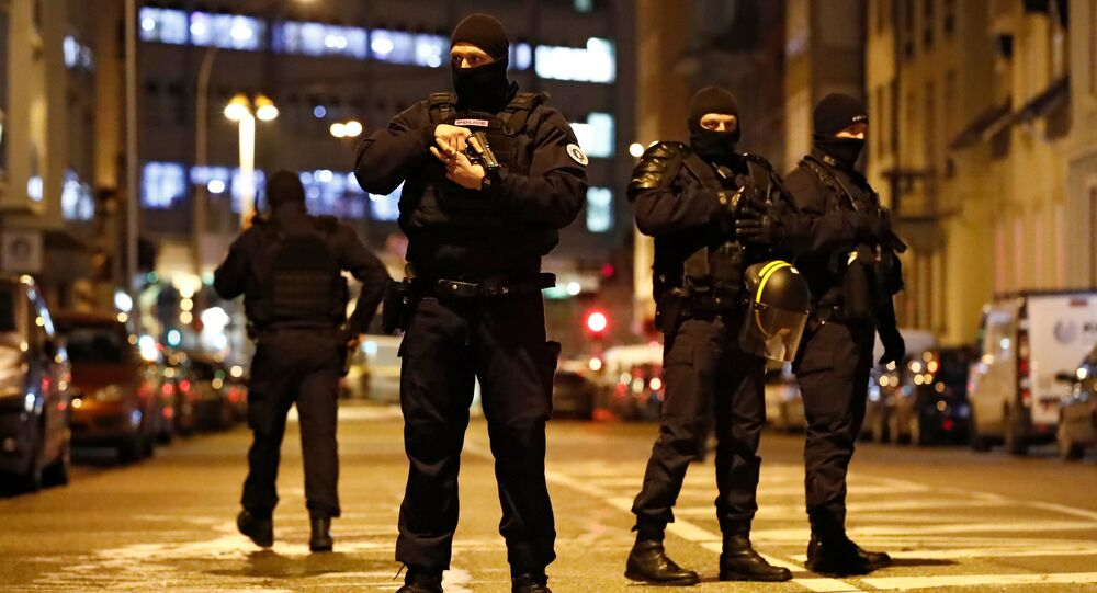 French special police forces secure an area during a police operation where the suspected gunman, Cherif Chekatt, who killed three people at a Christmas market in Strasbourg, was killed, in the Meinau district in Strasbourg, France, December 13, 2018.