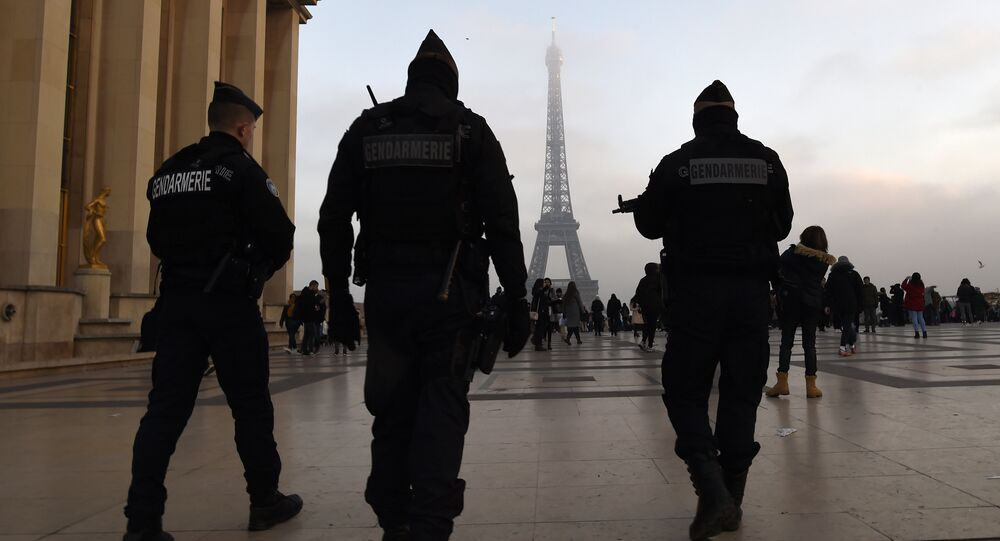 French gendarmes patrol in front of the Eiffel Tower one day before New Year's eve festivities in Paris on December 30, 2016