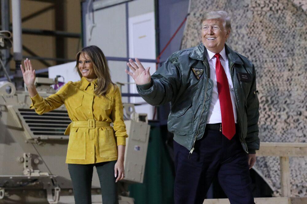 Le Président des États-Unis Donald Trump et son épouse Melania lors d'une visite de la base américaine Al Asad, Irak, 2018.