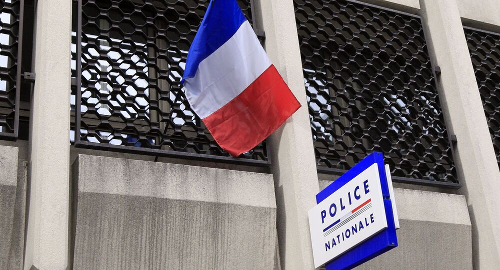 A French flag and a board indicating the police station of Vincennes, a southeastern Paris suburb, are pictured on March 5, 2012.