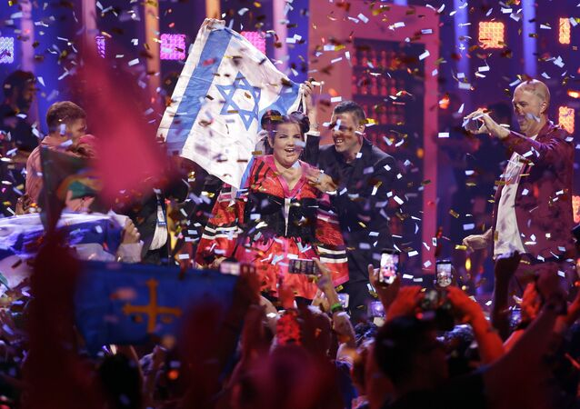 Netta from Israel celebrates after winning the Eurovision Song Contest grand final in Lisbon, Portugal, Saturday, May 12, 2018