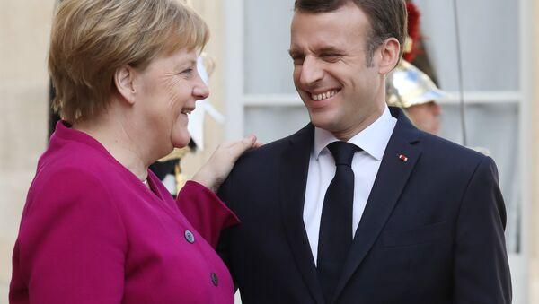 Angela Merkel et  Emmanuel Macron à l'Élysée - Sputnik France