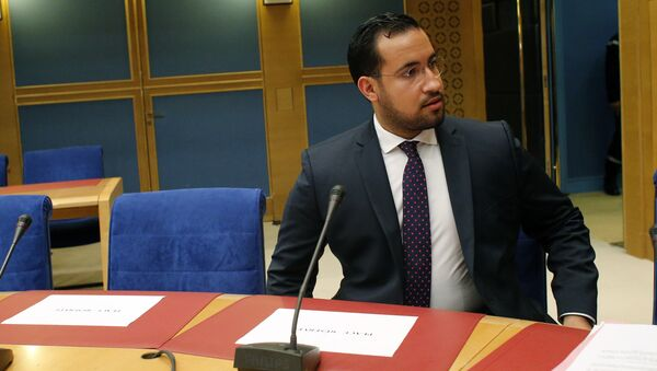 Former President Macron's security aide Alexandre Benalla, left, appears before the French Senate Laws Commission prior to his hearing, in Paris, France, Wednesday, Sept. 19, 2018. - Sputnik France