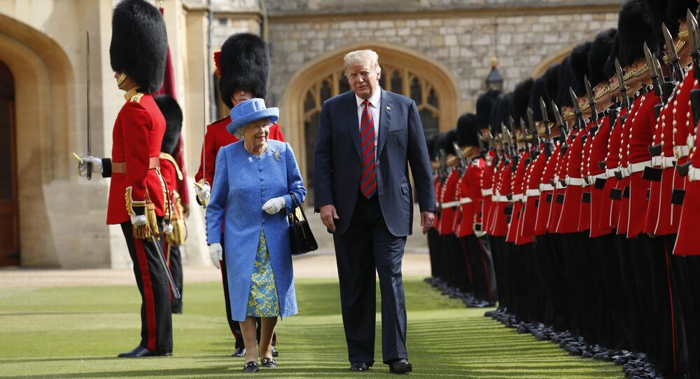 U.S. President Donald Trump with Queen Elizabeth II, inspects the Guard of Honour at Windsor Castle in Windsor, England, Friday, July 13, 2018