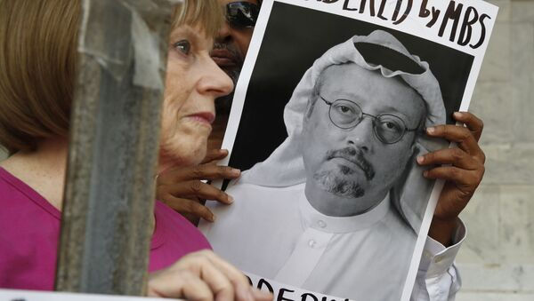People hold signs during a protest at the Embassy of Saudi Arabia about the disappearance of Saudi journalist Jamal Khashoggi - Sputnik France