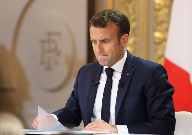 French President Emmanuel Macron reacts during his live address following the Great National Debate, at the Elysee Palace in Paris on April 25, 2019.