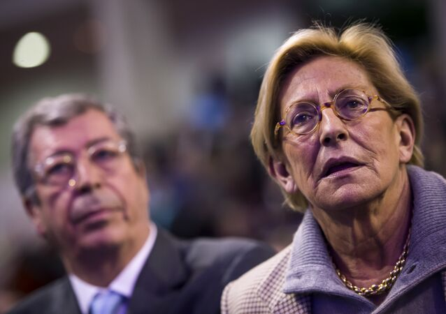 French right-wing Les Republicains (LR) party MP and Levallois-Perret's mayor Patrick Balkany and his wife Isabelle Balkany attend a public meeting for the campaign of the LR party's top candidate for the regional elections in the Ile-de-France region on December 3, 2015 in Rueil Malmaison.