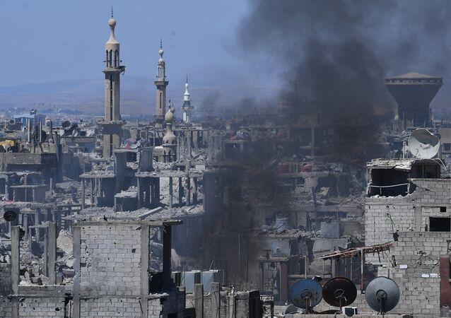 Assaut des positions de Daech* dans la zone de l'ancien camp de réfugiés palestiniens Yarmouk dans la banlieue sud de Damas
