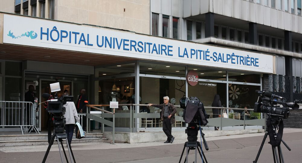 Cameras of the French media are placed in front of the entrance of the La Pitie Salpetriere Hospital where former French President Jacques Chirac has been hospitalized with a lung infection, in Paris, Monday, Sept. 19, 2016.