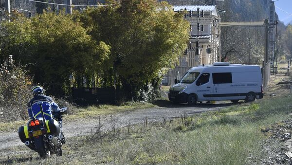 In this file photo taken on November 27, 2016 a French gendarme stands near a vehicle of the criminal identification unit of the French Gendarmerie near a crime scene near the communes of Tarascon-sur-Ariege and Ussat, southwestern France, where a French gendarme was run over and killed by a convicted criminal - Sputnik France