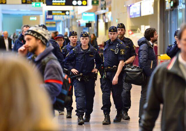 Swedish policemen patrol the Arlanda airport outside Stockholm, Sweden March 22, 2016.