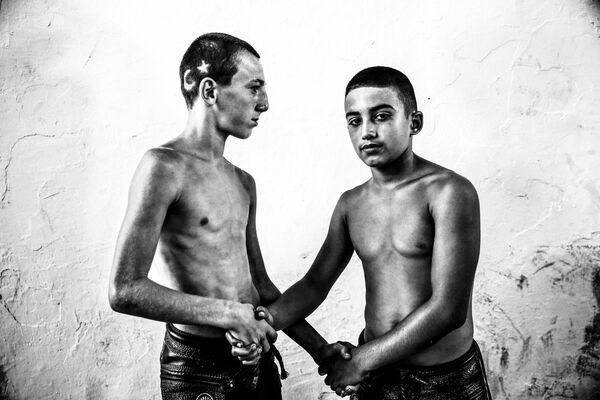 Festival de lutte turque du photographe turc Elif Ozturk Ozgoncu, finaliste dans la catégorie Sport, série de photos. - Sputnik France