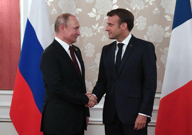 Vladimir Poutine et Emmanuel Macron. Archives