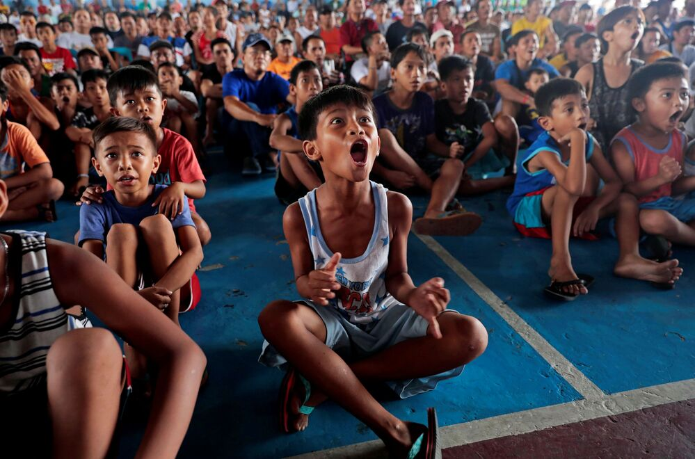 Filipino boxing fans celebrate after Manny Pacquiao wins the WBA Welterweight fight against Keith Thurman of the U.S. during a live public viewing of the match in Marikina, Philippines, July 21, 2019.
