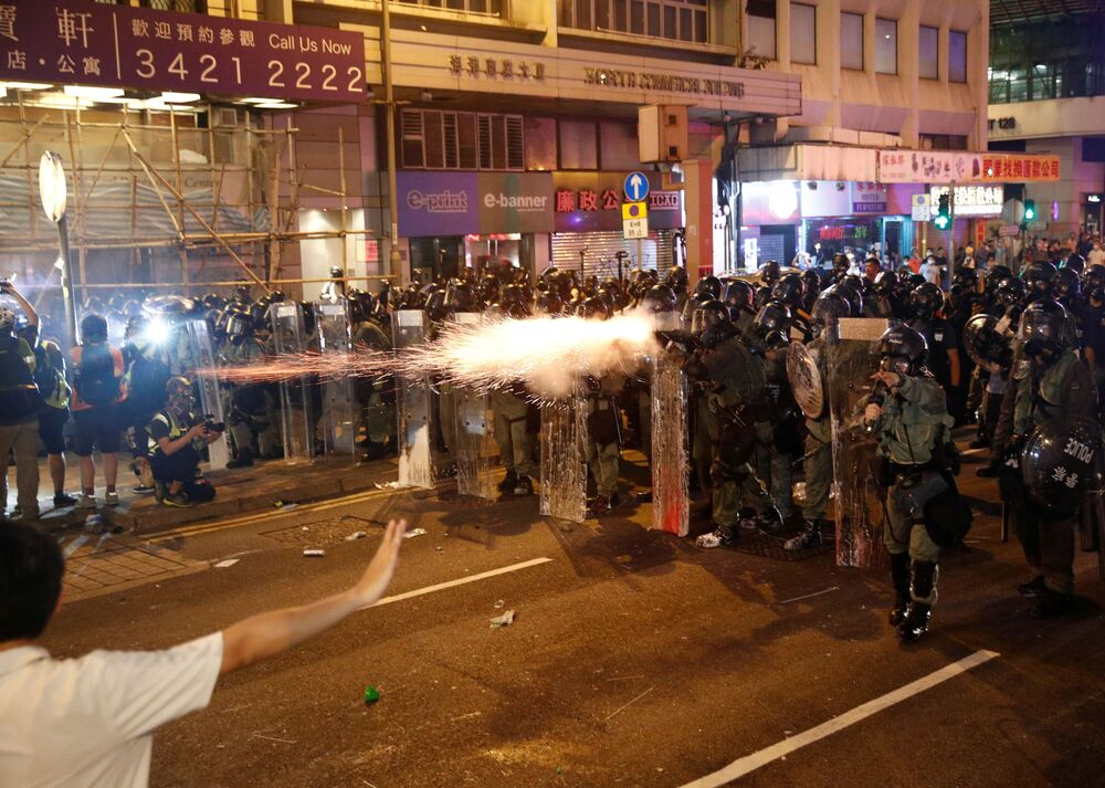 Riot police fire tear gas, after a march to call for democratic reforms in Hong Kong, China July 21, 2019.