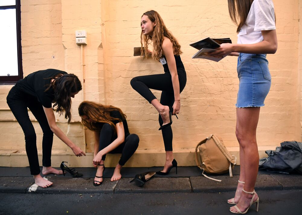 A model parades for the camera at a casting call for the the upcoming Melbourne Fashion Week on July 24, 2019. - Over 400 models paraded at the iconic Melbourne Meat Market to be one of 120-150 models selected for the fashion week running August 28 to September 5.