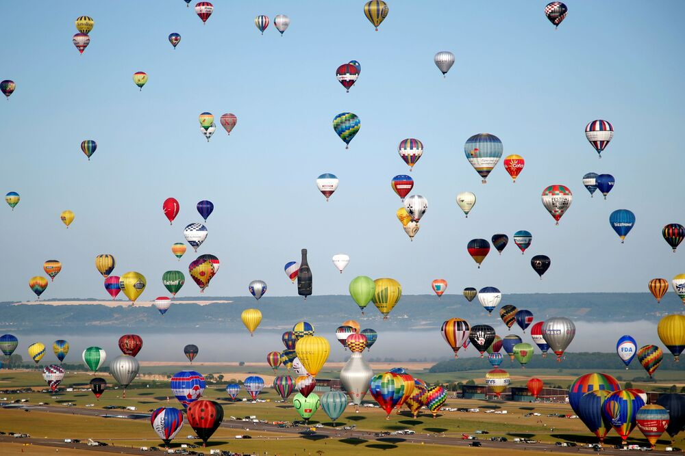 Hundreds of hot air balloons take part in the Great Line at the Mondial Air Ballons festival, in an attempt to break the 2017 record of 456 balloons aligning in an hour during the biggest meeting in the world, in Chambley, France, July 29, 2019.