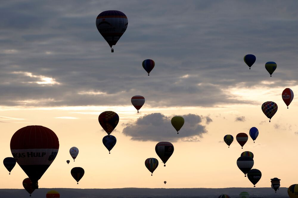 Hot air balloons fly at the Mondial Air Ballons festival in Chambley, on the third day of the biggest meeting in the world, France, July 28, 2019.